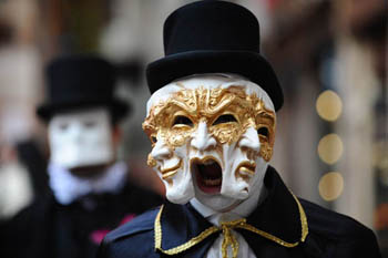 """Two costumed men pose near San Marco square in Venice 27 January at the beginning of the Venice Carnival """"Sensation"""". .AFP PHOTO / CHRISTOPHE SIMON (Photo credit should read CHRISTOPHE SIMON/AFP/Getty Images) HORIZONTAL"""